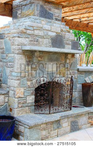 Outdoor cooking stove and fireplace