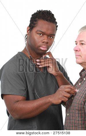 Male nurse listening to an older patient's heart