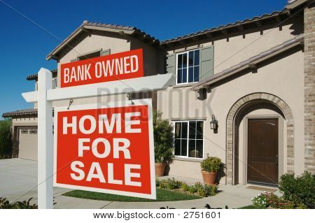 Bank Owned Home For Sale Sign In Front Of New House