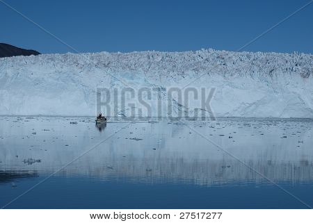 Boat In Front Of Glacier Eqi, Greenland.