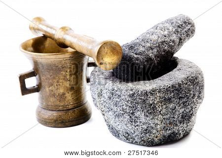 Granite And Brass Mortar With Pestles On A White