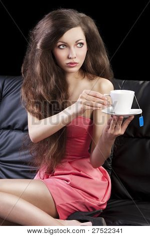 Sophisticated Lady Drinkig Tea, She Take A Cup Of Tea With Both Hands