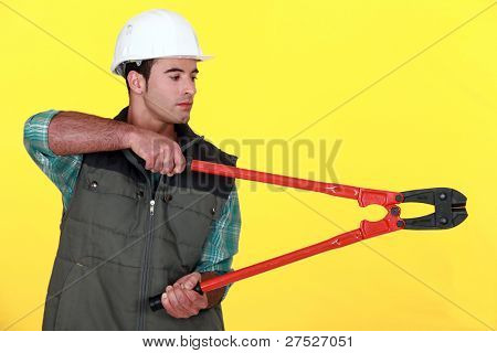 Tradesman holding large clippers