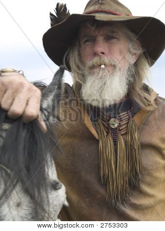 Rugged Cowboy With His Horse