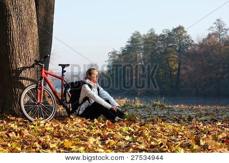 Peppy Woman Cyclist Enjoy The Recreation Autumn Morning In Nature