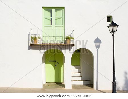 facade of typical rural house with balcony on the balearic islands