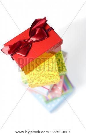 stack of colorful gift boxes, box with lanyard on top in focus