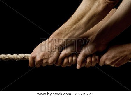 four hands pulling on a rope in one direction