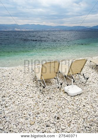 sunbeds at the beach of Kassiopi, island of Corfu, Greece