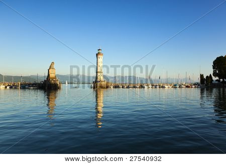 entrance to the harbor of Lindau at the Lake Constance with lighthouse and statue of bavarian lion