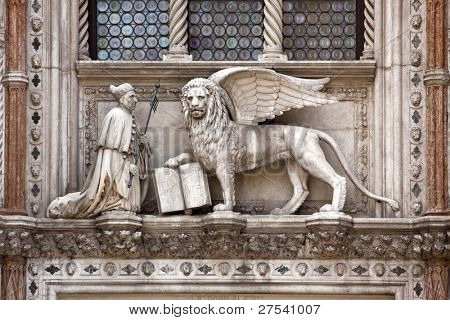sculpture at the Porta della Carta of the Doges Palace, venice: The doge kneeling in front of Saint Mark's lion, the symbol of Venice