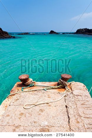 empty jetty with ropes at the harbor of Los Lobos, Canary Islands
