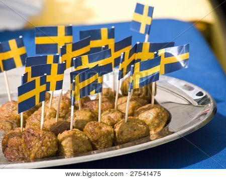 meatballs with swedish flags on toothpicks