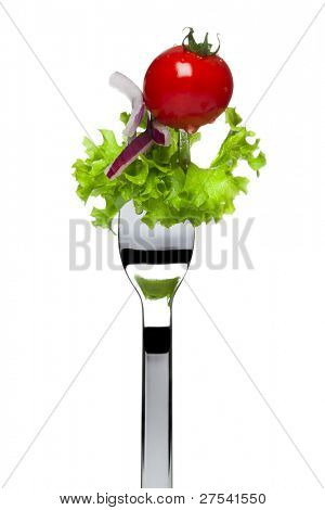 fresh salad consisting of lollo bionda lettuce, red onion and cherry tomato sticking on fork, isolated on white