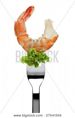 giant shrimp and piece of lettuce sticking on a fork, isolated on white