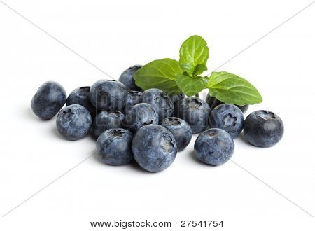 heap of blueberries with mint leaf isolated on white background