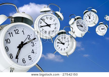 composing of several alarm clocks with varying hand positions flying through blue sky