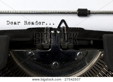 "close-up of the words ""Dear Reader"" written with old typewriter"