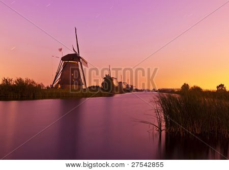 night shot of historic windmills of Kinderdijk