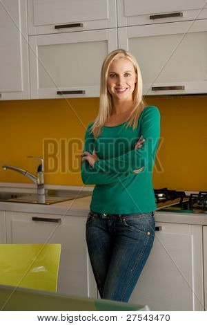 Beautiful young woman in clean kitchen