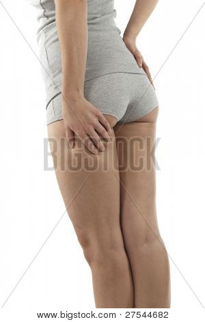 Woman checking her cellulite