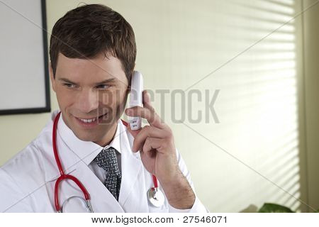 Male doctor speaking on the phone