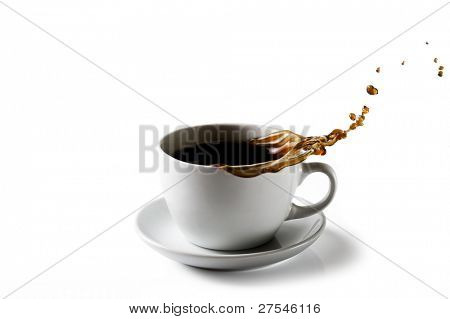 A cup of coffee with splashing coffee pouring out on to a white background