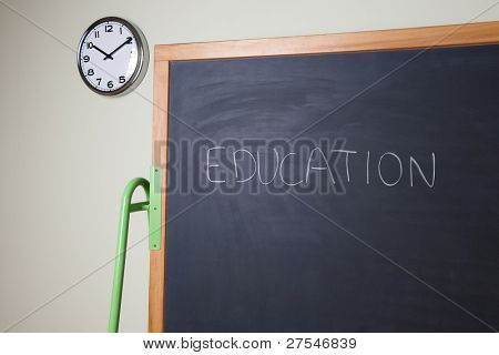 "Blackboard with empty diagram""Education"" written on it"