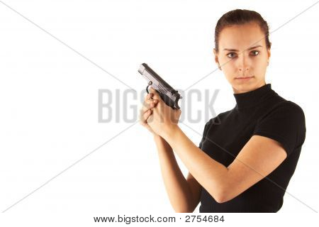 Cute Young Woman With Pistol. Isolated.