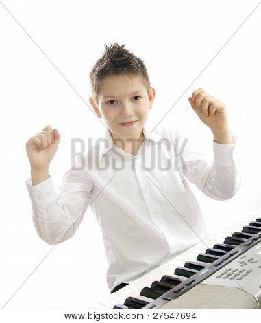 boy playing piano
