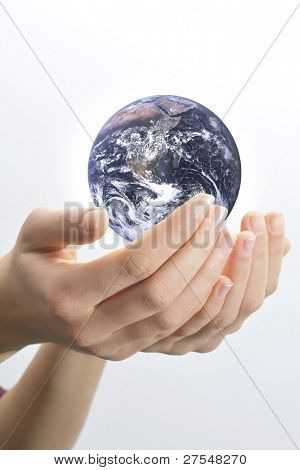 Female hands palms up on white background save the globe from falling. Globe image courtesy of NASA: http://visibleearth.nasa.gov