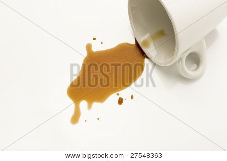 Cup with spilled coffee