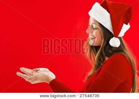 Smiling Santa Girl presenting your product, lots of copy-space