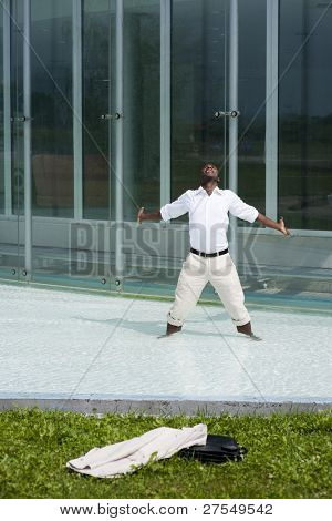 Businessman in the pool outside his office;  he could be excited beacuse he has just resigned