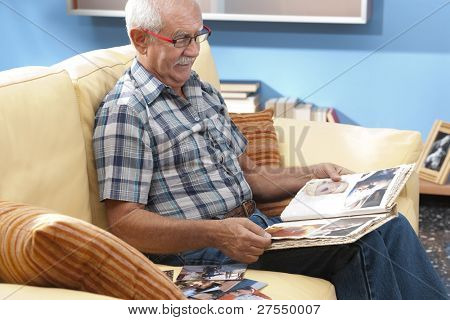 Grandfather looking at his grandson pictures