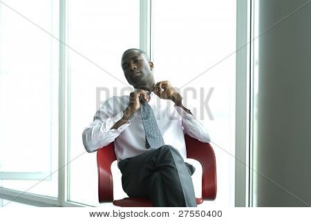 Young businessman loosening his tie