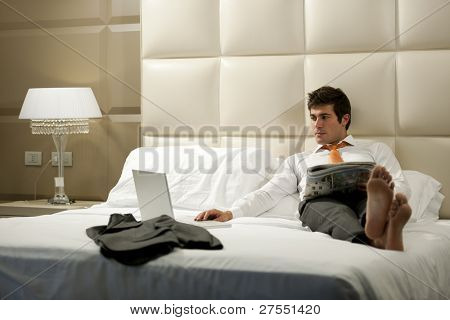 Relaxed Businessman reading newspaper