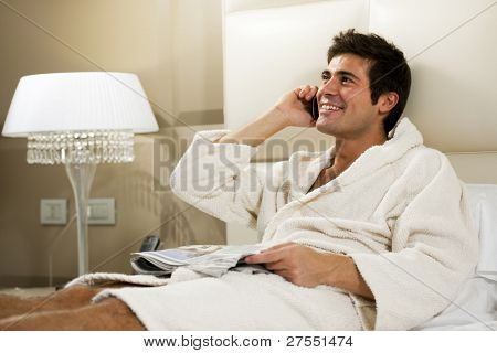 Relaxed Man in Bed, hotel or domestic room
