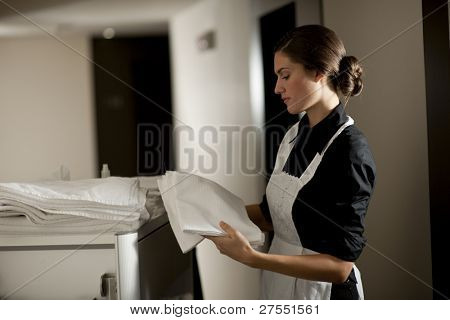 Maid with housekeeping cart