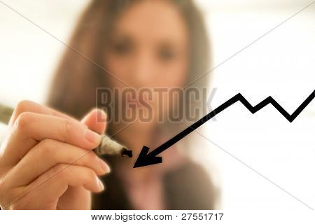 Businesswoman drawing a decreasing graph, focus on the graph