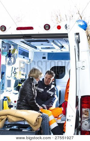 Male Paramedic Assisting Injured Woman