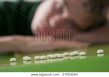 Teenage boy and pills
