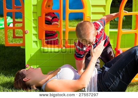Happy Family And Colorful Playhouse
