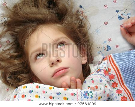 awaken little girl in the bed