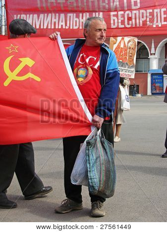 KALUGA, RUSSIA â?? MAY 1 : Demonstrators hold posters and flags at the annual communist meeting on the Labor Day May 1, 2009 in Kaluga.