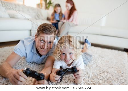Father and son in the living room playing video games together