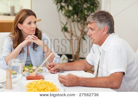 Family sitting at dinner table together