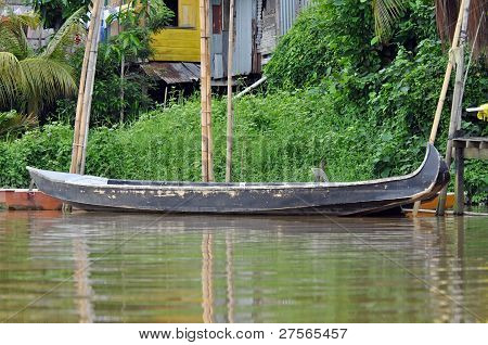 Local Boat On The River In Kuching
