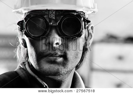 Black And White Photo Of A Man In Helmet And Goggles