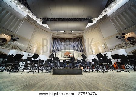 MOSCOW - FEB 26: Empty chairs stand on stage in Tchaikovsky Concert Hall, on Feb 26, 2011 in Moscow, Russia.  Each year, over three hundred concerts are held on stage of Tchaikovsky Concert Hall.